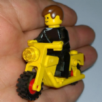 Lego retro 1984 yellow motorcycle and minifigure from set 6373